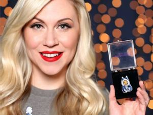 Ashley Eckstein showing off Her Universe's Star Wars collectible pin for Holiday 2016 (Image credit: Her Universe)