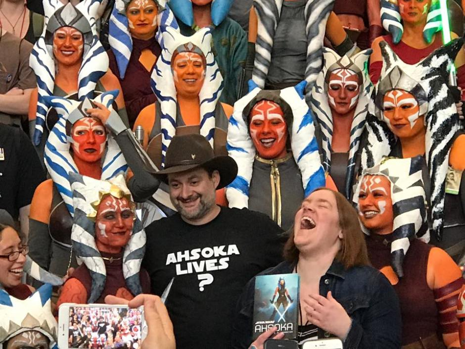 Dave Filoni surrounded by Ahsoka Tano cosplayers