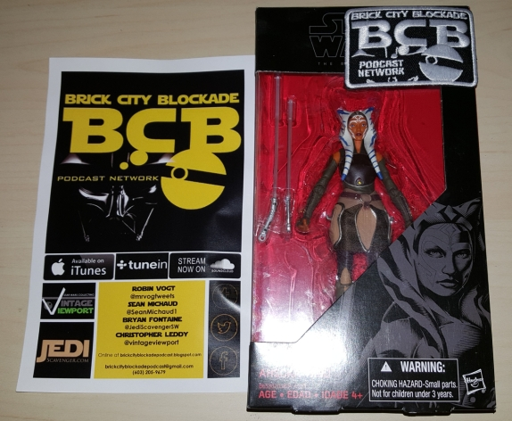 Hasbro's Black Series Ahsoka Tano action figure and promo material for Brick City Blockade Podcast Network